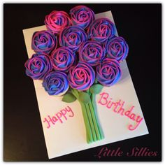 A two tone cupcake bouquet on a board.