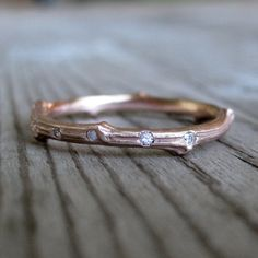 Rose Gold Scattered Diamond Twig Wedding Band, Recycled Gold, 2mm. $620.00, via Etsy.