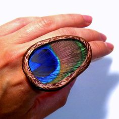 REAL Peacock Feather RING via Etsy.
