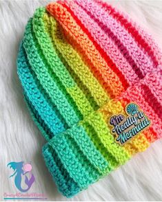 Materials: Worsted weight yarn (4) in Red Heart Super Saver Stripes Retro Stripes or any color of your choice. 6.00 mm (J) Hook: Teen/Adult size. 5.5 mm (I) Hook: Child size 5-10 year olds. 5.00 mm (H) Hook: Toddler size 1-4 year olds. Tapestry needle. Pom maker if making Pom. Crochet Terms: Ch- Chain Ch…