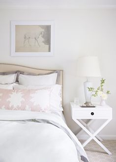 Gorgeous white bedding, with blush pinks accent in Style Me Pretty's Abby Larson's beautiful bedroom, as seen in Domino Magazine.