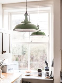 A country kitchen lit by two identical Factorylux pendants with green coolicon shades. Design your own pendant and receive FREE next day delivery.