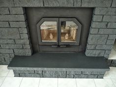 How to Easily Paint a Stone Fireplace (Charcoal Grey Fireplace Makeover) Fireplace Hearth Stone, Stone Fireplace Makeover, Wooden Fireplace, Slate Fireplace, Fireplace Doors, Paint Fireplace, Home Fireplace, Fireplace Remodel, Fireplaces