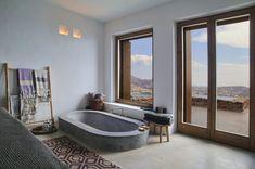 Sunken concrete tub with views of the Grecian coastline.