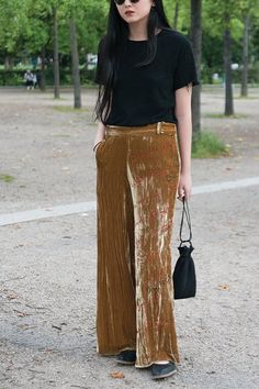 '90s Alert: How to Wear Velvet This Fall via @PureWow-Pants-widelegged pants (also known as secret pajama); keep accessories low-key. A black tee & minimal slippers; LC Lauren Conrad $45; Topshop $100; Alexander Wang $375