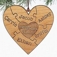 """This engraved wood heart puzzle ornament is beautiful! LOVE the heart puzzle piece design! You can add every family member's name and the middle says """"Together we make a family"""" - great ornament for blended families too!"""