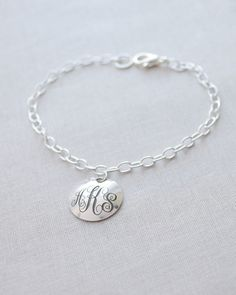 Monogram and Date Bracelet by Olive Yew. This make a great bride's gift that can include the marriage monogram and date.
