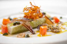 Photo of: Poached lemon sole with caramelised endive, glazed carrots, lardo di colonnata, clam and pistachio vinaigrette, Pied à Terre, Central London restaurant