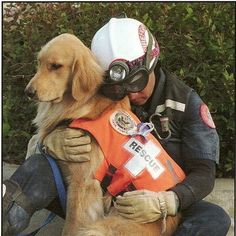 This is the picture of a rescue dog and his handler. They are taking a rest from searching for survivors from the Oklahoma City Bombing that happened on April 19, 1995.