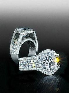 Bez Ambar two row blaze, split pave mounting with round brilliant center diamond.