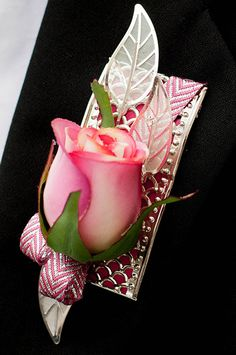 boutonniere bands provide a large base to give many options for designing this boutonniere was