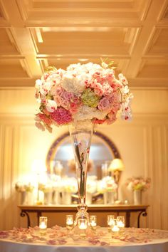I would love to have a few tall centerpieces like this!
