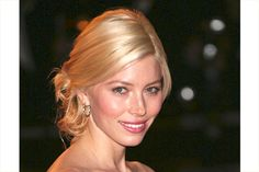 short hair vertically curled, front left sleek and pulled back. hide bobby pins with curls