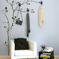 Stick on some wall stickers or paint a tree, add some hooks. Cute idea, I'd do it in my office!