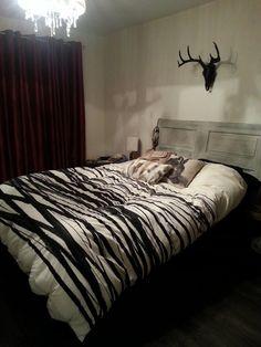 Our black faux deer skull is looking beautiful in this bedroom! We love it!