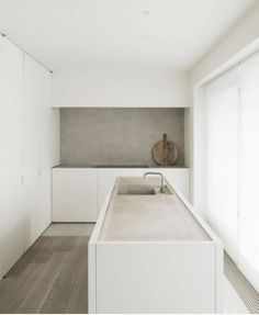 Modern kitchen interior design inspiration http://bycocoon.com | sturdy stainless steel kitchen taps | kitchen design | project design & renovations | RVS keukenkranen | Dutch Designer Brand COCOON | DD Apartment by Vincent Van Duysen