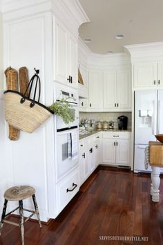 Savvy Southern Style: The Kitchen Reveal....Take Two| Santos Mahogany floor| white cabinets trimmed to ceiling