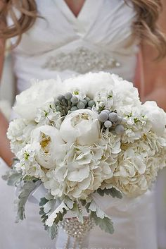 Trend Alert For Winter: Silver And Grey Wedding Bouquets ❤ See more: http://www.weddingforward.com/grey-wedding-bouquets/ #weddings #bouquets