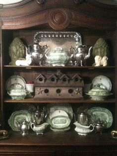 How beautiful is this brown transferware displayed in a hutch next to the richness of old silver.