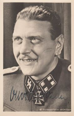 SKORZENY OTTO: (1908-1975) Austrian SS-Obersturmbannfuhrer of the German Waffen-SS during World War II, recognised for his involvement in the mission to rescue Benito Mussolini from captivity, September 1943. A good vintage signed postcard photograph of Skorzeny in a head and shoulders pose wearing his uniform and Knight's Cross. Photograph by Heinrich Hoffmann of Munich. Signed by Skorzeny in bold fountain pen ink with his name alone to the base of the image.