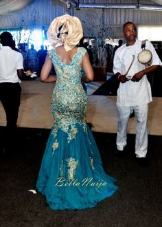 The BACK of the dress.Tolu & Bode | Lagos Nigerian Yoruba Wedding | BellaNaija | Photonimi | 090 blue and gold gele bride. Mermaid dress