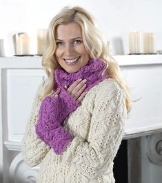 Ravelry: Cablewing Accessories pattern by Linda Marveng Cablewings surrounded by lace gives these accessories a flowery expression. They coordinate with the Cablewing Sweater; for a wonderfully regal look pair the wrap with the sweater. It is warm, practical but also decorative. All accessories are knitted in a pure wool with bounce, Embla from Hifa. I chose an irresistible purple-pink shade, well suited for the stitch pattern, for the cowl and the wristwarmers.
