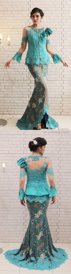 Kebaya dengan detail tangan terompet dan rok batik bordir (IG @ratukebaya_medan)