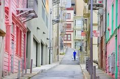 This lovely image above of an alley in North Beach by Mitchell Funk takes my breath away. San Francisco is quite a colorful city, but never saw it in a pastel kinda way.Oh Spring, please come visit us soon! Places Around The World, Oh The Places You'll Go, Places To Travel, Places To Visit, Around The Worlds, Beautiful Buildings, Beautiful Places, North Beach San Francisco, San Francisco Pictures