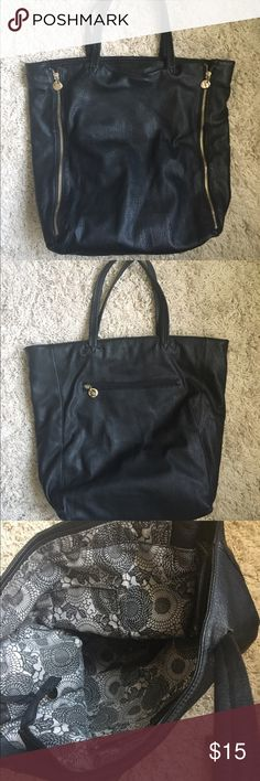 Large black tote with gold hardware This bag has a minor sign of wear in one of the straps(see pictures) and normal wear on the inside. When on it looks new. In perfect condition. Bags Totes