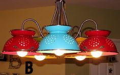 Colander chandelier - I'm going to get this or make one of my own.