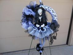 "Wreath by Designer Wreaths  http://designerwreaths.biz/ This cute witch wreath features many designs and styles of ribbon. The ones purchased from http:/www.trendytree.com are the black mesh tubing, 10"" solid black mesh roll, and my favorite is the white spider web mesh...I LOVE THIS PRODUCT! Thanks, Jeannie and staff for your great products!"