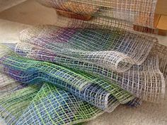 Linen lace weave scarves just off the loom. 16/1 linen crammed and spaced.