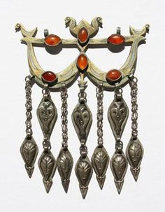 Turkmen Pendent. Archery-bow-shaped pendants or amulets are found across Central Asia. High karat gold fire gilding on silver set with old cat's eye carnelians.