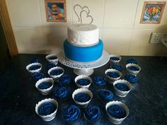30th wedding anniversary, blue white and silver cake with blue rose cupcakes