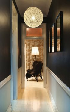 """I love black, or very dark brown, walls.  They have an ability to """"push"""" back the edges of a room, and make it seem larger."""