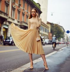 Kristina Bazan tan top and skirt