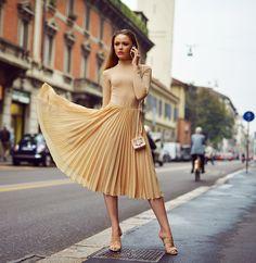 Kristina Bazan tan top and skirt