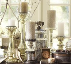 Candles are a must have during the holidays.  I love white and silver ones admist all of the red and green decorations