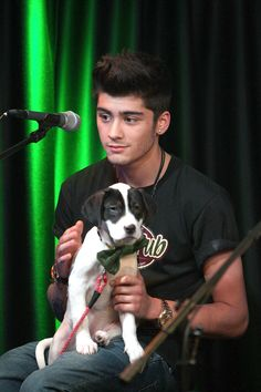 With a puppy in a bow tie, for maximum melting of ovaries.   - Seventeen.com