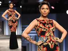 black gown with heavily embroidered bodice