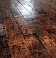 Dark rustic wood flooring...also many other flooring choices on this link...Recuperando