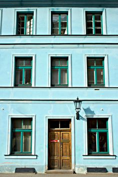 Pale turquoise exterior with darker turquoise trim in Riga, Latvia
