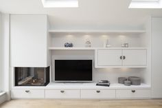Built in gas fire, TV and display shelving with LED lighting and drawers for DVD's.