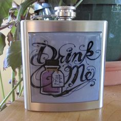 Always have a bit of wonderland in your back pocket or purse!  Makes an awesome gift or a treasured keeper.  This is a brand new stainless steel liquor hip flask. It holds 6 ounces of fluid. It comes boxed. The size is approximately 3 3/4 wide by 4 1/2 high to the cap by 1 thick with a curve. Fits perfect in your pocket. All of my flasks are HAND inspected for leaks, rust, residue, dents and other imperfections. I reject 1/2 of all flasks before making them and sell them in bulk to my…