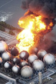Oil refinery facility is on fire in Ichihara, Chiba Prefecture, near Tokyo, Friday, March 11, 2011 | Kenji Tada