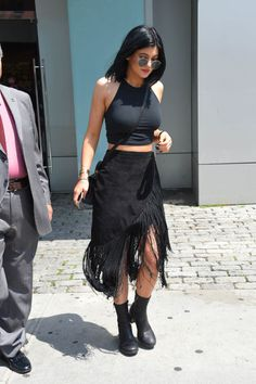 Kylie made a fringe-y skirt fit with her edgy style by sticking to her signature all-black and adding tough boots.