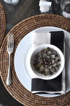 round wicker placemats, succulents, black linen napkins