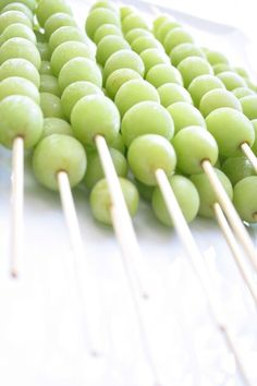 baby shower food. frozen grape skewers. Put in drinks to keep them cold w/o watering drink down
