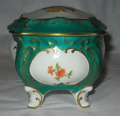 Here's a vintage JLMENAU GRAF VON HENNEBERG porcelain trinket box. The trademark shows that it was manufactured between The main color is green with gold gilt and beautiful hand-painted flo. East Germany, Box With Lid, Main Colors, Trinket Boxes, Beautiful Hands, Tart, Hand Painted, Antiques, Vintage