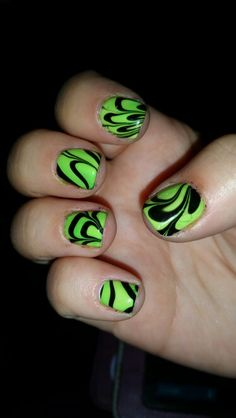 Green and black marble nails.